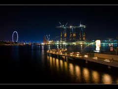Marina Bay at Night (Mio Marquez) Tags: city wheel night marina canon landscape ir evening bay three flyer singapore long exposure shot angle towers wide lion ferris casino resort sands dslr ultra efs merlion 1022 2010 waterscape integrated uwa 40d mmarquez