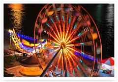 2209 Landscape of Taiwan    -  2010 .     2010 Kaohsiung Lantern Festival . Ferris wheel . Kaohsiung City .TAIWAN (deepblue68) Tags: world life new city travel light shadow people color art love water wheel playground sign festival night port outdoors pier photo cityscape tour image harbour glory traditional year joy culture taiwan led explore vision kaohsiung ferriswheel lighttrails lantern moment formosa      2010  cityview  loveriver