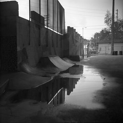 The rain keep pouring down (QsySue) Tags: camera blackandwhite reflection tlr water concrete parkinglot rainyday pavement 120film mudpuddle lubitel166b twinlensreflex expiredfilm developedathome agfafilm reallyoldfilm sanpedroskatepark isopaniss like30yearsold titleisavanmorrisonlyric underthe110freeway
