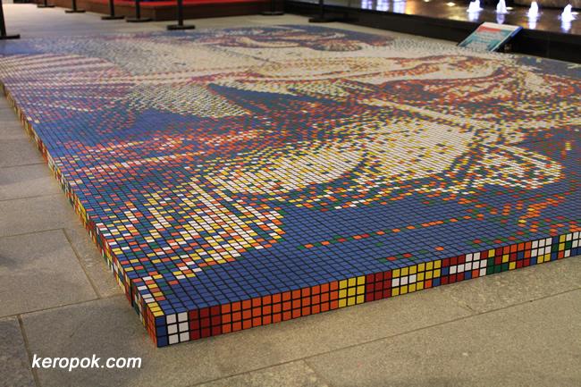 Yes, portrait's arranged with Rubik's Cube