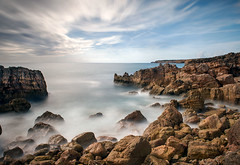 Rocks (petefoto) Tags: blue sea seascape blur portugal water clouds landscape dangerous rocks waves peace coat atmosphere windy pebbles cliffs atlantic coastal splash filters foreshore polariser nd110 ingrina nikond700 leefilters09sgrad portugalpraidoingrina viladabispo