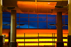 Cool Blue Reason (code poet) Tags: blue light sky orange yellow alaska clouds lights airport columns ceiling anchorage 5d column sconce fixture 24105mm