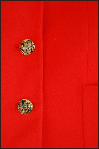 buttons on the vintage red-orange wool jacket