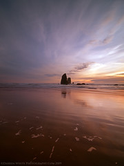 Under Sunset Skies (Darren White Photography) Tags: cannonbeach oregon oregoncoast beaches sunsets sky clouds ocean shoreline sand seastacks landscapephotography fineartphotography traveloregon oregontravel scenicoregon pacificnorthwest northwest darrenwhite darrenwhitephotography fineartlandscapesofthepacificnorthwest nikon d300