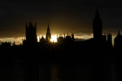 Houses of Parliament (Richard Cooper Photography) Tags: uk sun black london clouds photoshop nikon housesofparliament lensflare rays riverthames silhuette d60