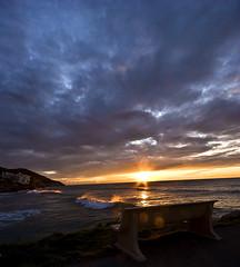 Banco para sentarse a la espera del espectaculo (Zac) Tags: sunset sea sun water sunrise mar banco wave amanecer zac sitges olas ricard meditarranean meditarraneo