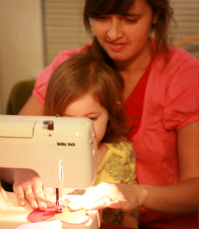 mother sewing with a child