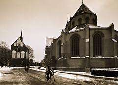 Fahrradfahrer in Norden (ramagrrl) Tags: winter church delete10 delete9 germany delete5 delete2 delete6 delete7 norden delete8 delete3 delete delete4 save save2 bikers northerngermany fahrradfahrer deletedbydeletemeuncensored