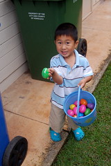Owen by the garbage cans with some of his loot
