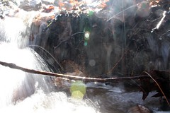 accidental (andreaa jean) Tags: water flow waterfall exposure shine slow sunflare
