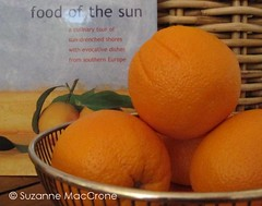 Food of the Sun (Suzanne MacCrone Rogers ~ Italian Girl in Georgia) Tags: sky food green yellow fruit silver book juicy basket citrus oranges wicker vitaminc italiangirlingeorgia