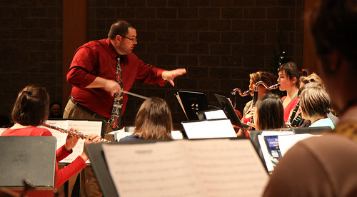 Conductor Mr. Graham leads one of his bands at the Festival of Trees.