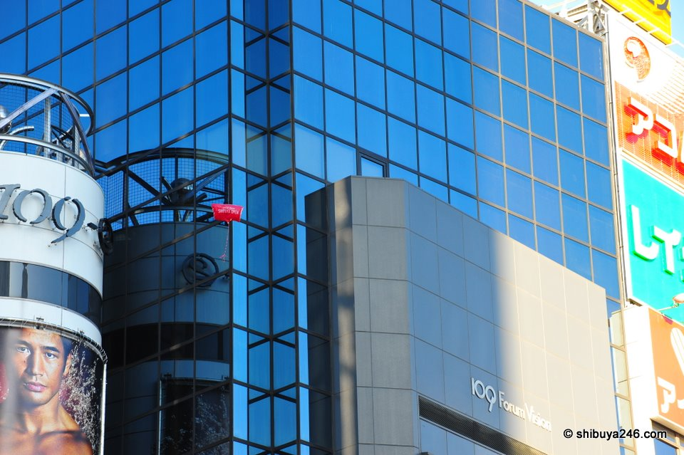 One of the balloons scales the 109 building.