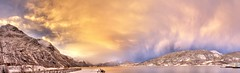 Rauma (Lisa-Mari) Tags: blue winter sunset sea sky panorama cloud mountain snow mountains cold reflection water yellow norway clouds canon lens eos norge frost kitlens panoramic fjord kit blizzard hdr rauma romsdal andalsnes mreogromsdal ndalsnes 450d moreogromsdal aandalsnes