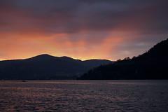 Tornero' (ale.ian) Tags: sunset italy lake como montagne lago soleil italia tramonto sole riflessi luce raggi riflesso torno