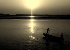Beautiful Sunset (Kkkib) Tags: cameraphone sunset art water river landscape photography evening village live sonyericsson land lovely soe bangladesh breathtaking mywinners nouka flickraward nephkkkib