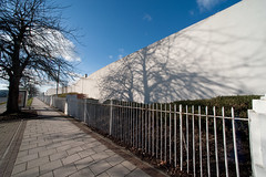 Great West Road (gidsey_) Tags: uk shadow england west tree london fence geotagged artdeco a4 railings westlondon brentford goldenmile isleworth greatwestroad wallisgilbertandpartners