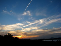Flying towards sunset (Adriana Rbel) Tags: sunset sky clouds cu prdosol cielo nuvens