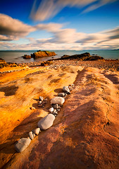 Dysart Rocks (ajnabeee) Tags: ocean longexposure sunset cloud motion beach water rock coast scotland rocks shadows fife dusk stones bluesky filter firthofforth kirkcaldy dysart vle 10stop nd110 shahbazmajeed