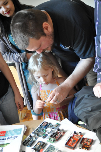 Father and daughter looking at the evolution of Arduino models
