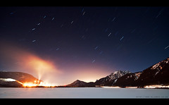 (c@rljones) Tags: longexposure winter lake snow canada mountains car night dark stars rockies frozen industrial factory glow lakeside stellar alberta canmore cosmos lighttrail startrail celestialequator canada2010