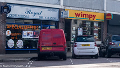 The Wimpy Bar (M C Smith) Tags: shops cars parking wimpy yellow pentax k3 van red white lines shopping food