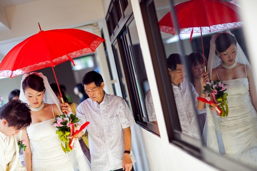 Commonly seen in Cantonese tradition - the red umbrella
