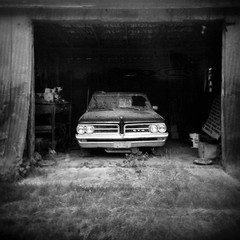 Southern Chariot (evanleavitt) Tags: county summer bw abandoned 6x6 film rural ga georgia holga ride darkness conversion decay south memories scan american weathered medium format gto laurens 120n the