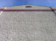 (halflifehalflived) Tags: sky chicago facade corporate stripes symmetry lookingup cinderblock publicstorage corporatearchitecture