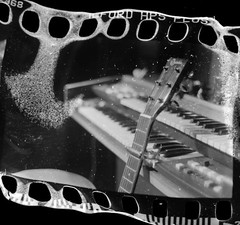 Silent (Quiet Corners) Tags: bw music slr film home halloween 35mm fire nikon sink distorted guitar live band holes dirt organ burn edge worn portsmouth match hp5 manual dust damaged instruments developed ilford southsea 400iso nikonfe2 cellars fe2 homedeveloped eastney