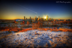 Sunset on Calgary (SLiDegt) Tags: city sunset snow canada calgary skyline photoshop canon lens saddledome downtown angle 4 wide filter alberta pro cs z 1022mm hdr 1022 cokin gradual photomatix 400d zpro