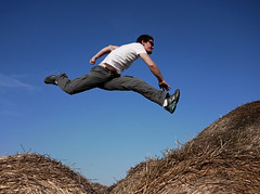 the correct way to jump on hay bales (ssj_george) Tags: blue sky people man nature lens jump jumping movement action farm air cyprus nike panasonic midair pancake 20mm hay bales leap kiti larnaca f17 gf1 superapl