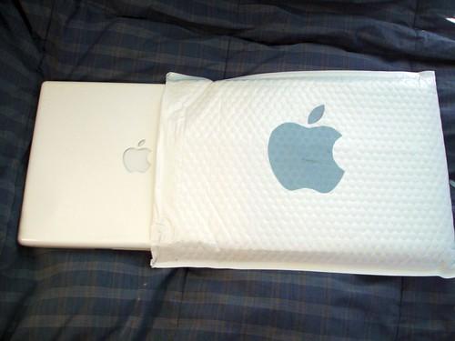 Apple laptop next to bubble sleeve