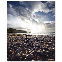 Pebbles on a beach Monday Blues under Stratocumulus s