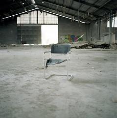 (Andrs Medina) Tags: slr abandoned industry 120 6x6 film analog mediumformat chair empty hangar ruin nave bronica urbanexploration abandonment texturas graffitis bronicas2 zenza ko