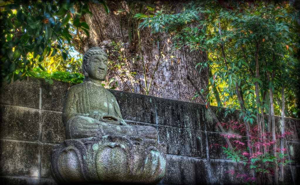 Buddha meditating away on his lotus blossom in a peaceful zen temple in Okazaki.
