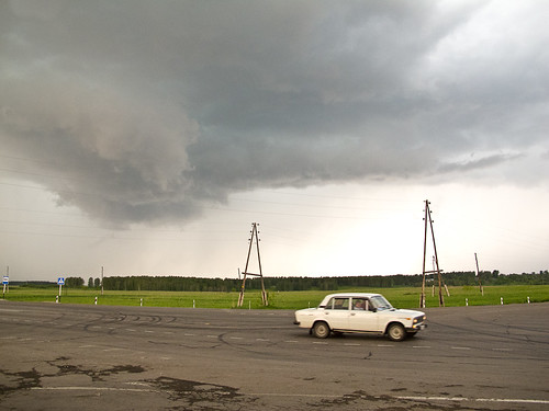 Storm clouds + car