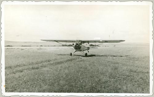 Light plane taking off.