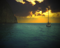 Escape from reality (ceca67) Tags: sea sun water rock clouds island boat horizon greece zakynthos gpc imagepoetry theoldport concordians lesamisdupetitprince miasbest worldsartgallery daarklands yourwonderland flickrvault magicunicornverybest coth5 selectbestfavorites trolledproud imagofabulae