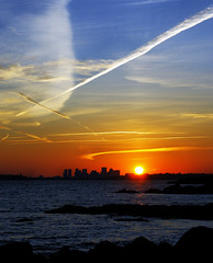 Boston Skyline (Drippy2009) Tags: blue sunset sky orange boston clouds skyscraper trails nahant