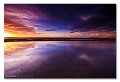 A Common Wave Phenomenon. ([ Kane ]) Tags: light sky sun water clouds reflections photography mirror sand rocks dusk australia brisbane qld queensland kane shallowwater wellingtonpoint gledhill sigma1020 50d kanegledhill wwwhumanhabitscomau kanegledhillphotography