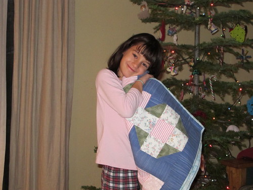 Lil' Mermaid loving her quilt from her Memere