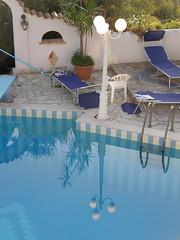 riflettendo in piscina...idea! (epimik) Tags: italy water italia piscina swimmingpool sicily acqua riflessi 2009 sicilia bonagia estane villalepalme