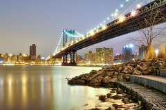 manhattan x2 (mudpig) Tags: nyc newyorkcity longexposure bridge newyork skyline brooklyn night geotagged cityscape dumbo esb manhattanbridge eastriver empirestatebuilding hdr hanukkah mudpig stevekelley