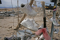 Shoe Tree along CA-62 (California USA) (Meteorry) Tags: california ca usa art america fence highway december unitedstates desert rice sandals unitedstatesofamerica running sneakers nike footwear baskets 2009 shoetree swoosh meteorry vidaljunction skets ca62 nikeairforce