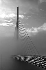 Pont & brouillard - Bridge & fog [explore] (Le P'tit Nicolas) Tags: road bridge sky france fog clouds blackwhite nikon highway europe route ciel pile nicolas pont autoroute nuages a75 millau noirblanc viaduc 18200mm d90 viaducdemillau fraineau