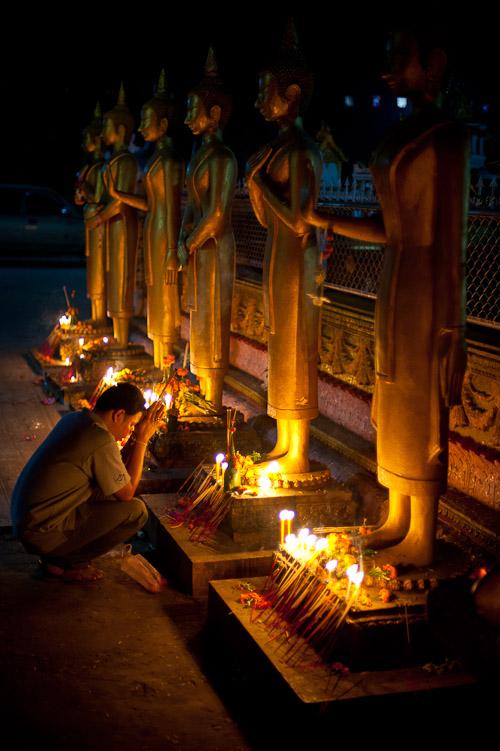 Praying at Wat Si Muang, Vientiane, Laos