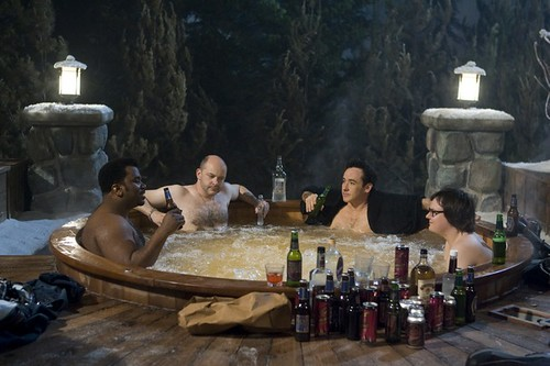 (L-R) Craig Robinson, Rob Corddry, John Cusack, and Clark Duke keep it far from real -- but still pretty funny -- in 'Hot Tub Time Machine'.