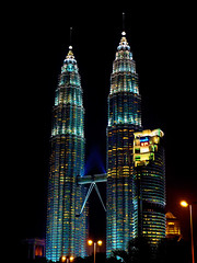 Twins (Mutuma) Tags: city building architecture night buildings lights cityscape petronas towers malaysia kuala kualalumpur hdr lumpur petronastower slyline lumixaward