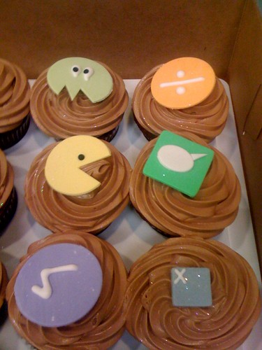 geeky cupcakes with pac man and the like on them